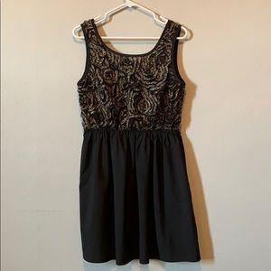 Flora gold and black dress